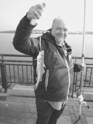 Black and white photo of Peter with a fish