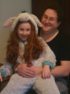 Alex and his daughter in a bunny onesie.